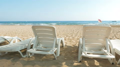 White beach chairs or beds near sea or ocean shore Stock Footage