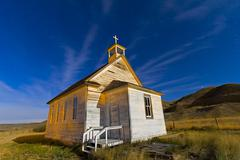 The old pioneer church in Dorothy, Alberta, Canada, on a starry night. Stock Photos