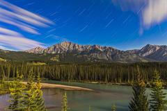 Star trails above the Front Ranges in Banff National Park, Alberta, Canada. Stock Photos