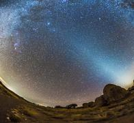 Comet Lovejoy and zodiacal light in City of Rocks State Park, New Mexico. Stock Photos