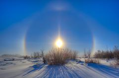 High dynamic range photo of sundogs and a solar halo around the Sun. Stock Photos