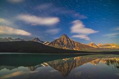 Star trails behind Mount Chephren in Banff National Park, Canada. Stock Photos