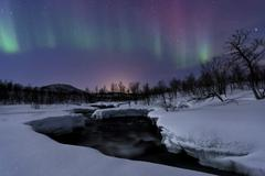 Aurora Borealis over Blafjellelva RIver in Troms County, Norway. Stock Photos