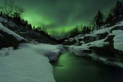 Aurora Borealis over Tennevik River, Troms, Norway. Stock Photos