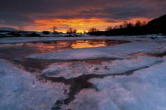 A fiery sunrise over Lavangsfjord, Troms, Norway. Stock Photos
