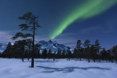 Aurora Borealis over Nova Mountain Wilderness, Troms, Norway. - stock photo