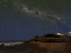 The Milky Way over the cliffs of Miramar, Argentina. Stock Photos
