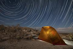 Star trails above a campsite in Anza Borrego Desert State Park, California. Stock Photos