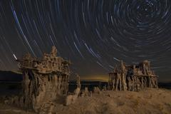 Star trails and intricate sand tufa formations at Mono Lake, California. Stock Photos