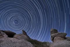 A boulder outcropping and star trails in Anza Borrego Desert State Park, Stock Photos