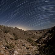 Star trails over the rugged canyon in Anza Borrego Desert State Park, Stock Photos