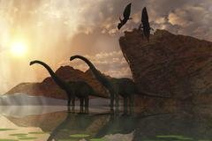 Diplodocus dinosaurs and pterodactyl birds greet the early morning mist. Stock Illustration
