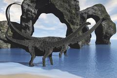 Diplodocus dinosaurs wade through shallow waters of a beautiful seashore. - stock illustration