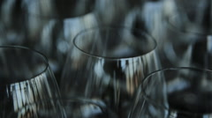 Many empty crystal wine glasses stands on table Stock Footage