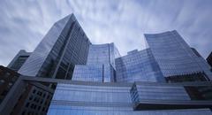 Steel blue glass skyscrapers Stock Photos