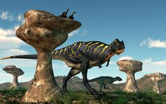 A pair of Aucasaurus dinosaurs walk amongst a forest of stone sculptures. - stock illustration