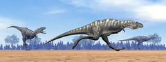 Three Aucasaurus dinosaurs running in the desert. - stock illustration
