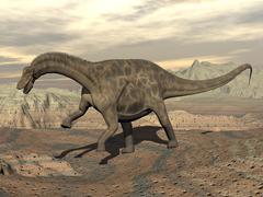 Large Dicraeosaurus dinosaur walking on rocky terrain. Stock Illustration