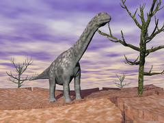 Argentinosaurus standing on the cracked desert ground next to dead trees. Stock Illustration