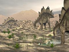 Stegosaurus dinosaurs searching for water in a desert landscape. Stock Illustration