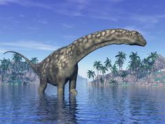 Argentinosaurus dinosaur grazing in a tropical climate. Stock Illustration