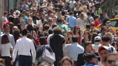 Crowd of commuter people walking street sidewalk slow motion Stock Footage
