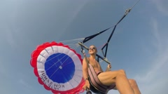Young Man Parasailing with GoPro in Blue Sky over Sea. 4K. - stock footage