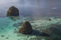 Limestone islands surrounded by a coral reef in Raja Ampat. Stock Photos
