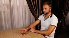 Young trendy attractive man drinking whiskey in cafe Stock Footage