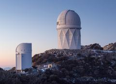 The Mayall Observatory sits atop Kitt Peak at sunset, Arizona. Stock Photos