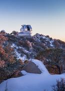 The WIYN Observatory on top of snow capped Kitt Peak, Arizona. - stock photo