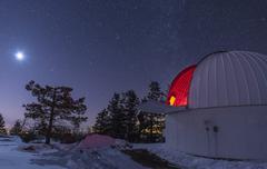 Moonlight illuminates the Schulman telescope on Mount Lemmon. Stock Photos
