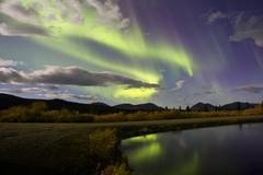 Aurora borealis with moonlight at Fish Lake, Yukon, Canada. Stock Photos