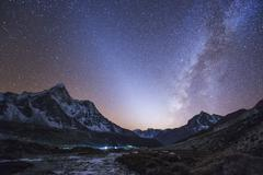 Milky Way and zodiacal light ove the Himalayas in eastern Nepal. Stock Photos