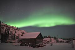 Aurora borealis over a cabin, Northwest Territories, Canada. Stock Photos