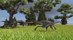 Three Gigantoraptors running across a grassy field. - stock illustration