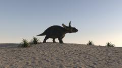 Triceratops walking across a barren landscape. - stock illustration