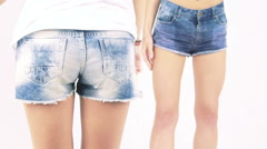 Two young girl shaking buttocks on a white background. Slowly Stock Footage