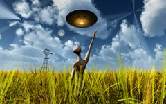 An alien being directing its spacecraft to make crop circles. Stock Illustration