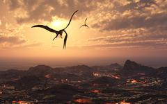 A pair of giant Quetzalcoatlus flying over a volcanic landscape. Stock Illustration