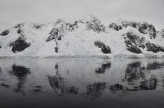 Antarctic mountains reflected in the sea, Antarctica. Stock Photos