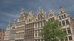 CLOSE UP: Rich golden ornamentation on monumental buildings at Grote markt Stock Footage