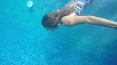 Woman Diving Underwater in Bikini in Swimming Pool. Slow Motion. - stock footage