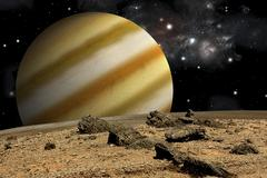 A large cloud covered planet rises over a rocky and barren alien world. Stock Illustration