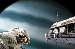 Astronauts performing work on a space station while orbiting a Jupiter-like Stock Photos