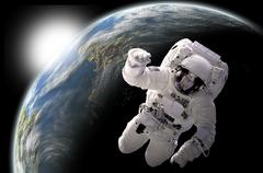 Astronaut floating in outer space with visible sunrise from an Earth-like Stock Illustration