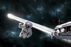 A comet passes dangerously close to astroanuts working on space station. Stock Illustration
