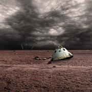 A scorched space capsule lies abandoned on a barren world. Stock Photos