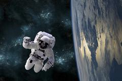 An astronaut floating above Earth. - stock photo