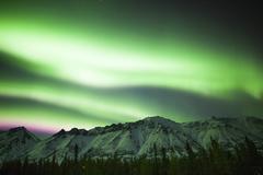 Bright aurora borealis over Annie Lake, Yukon, Canada. Kuvituskuvat
